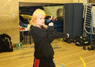 Young female in cadet kickboxing class Birmingham